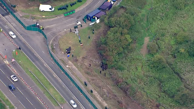 exterior aerial shots of police and forensic detectives examining the scene of the shoreham air disaster which killed 11 people on september 1 2015... - ショーハム・バイ・シー点の映像素材/bロール
