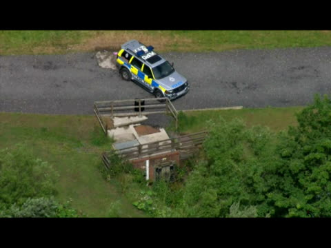 vidéos et rushes de exterior aerial shots of police car parked near the storm drain where it is thought raoul moat hid during the week long manhunt for him storm drain... - nord est de l'angleterre