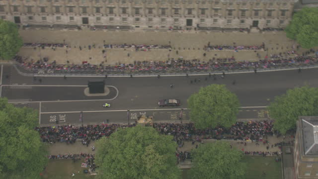 Exterior aerial shots of Prince William Prince Harry travelling in cars taking them to Westminster Abbey Sky News Royal Wedding Procession Footage on...