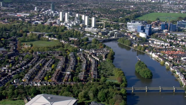 GBR: Aerials over Richmond & Ealing, housing & River Thames