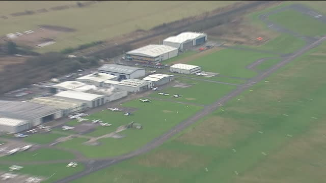 exterior aerial shots of shoreham airfield and busy a27 road with traffic passing on 3 march 2017 in shoreham united kingdom - ショーハム・バイ・シー点の映像素材/bロール