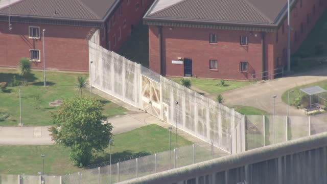 vídeos de stock, filmes e b-roll de exterior aerial shots of swaleside prison on the isle of sheppey on 13 august 2019 in sheppey kent - cela de prisão