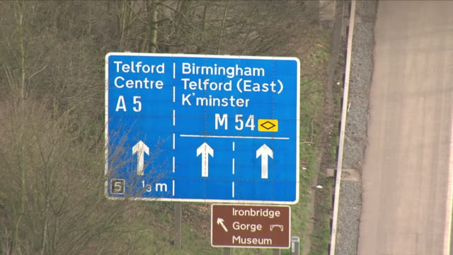 exterior aerial shots of telford town centre including shots of telford streets and houses and shots of the m54 motorway sign towards birmingham,... - birmingham england stock videos & royalty-free footage