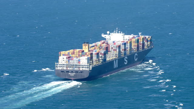 exterior aerial shots of the container freight ship msc flavia sailing through the english channel on july 21 2015 in calais france - 密輸点の映像素材/bロール