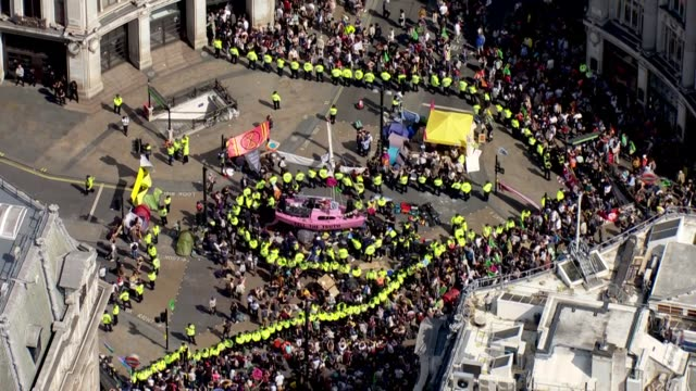exterior aerial shots of the extinction rebellion protest with a pink 'tell the truth' yacht blocking the middle of oxford circus surrounded by a... - pink stock videos & royalty-free footage