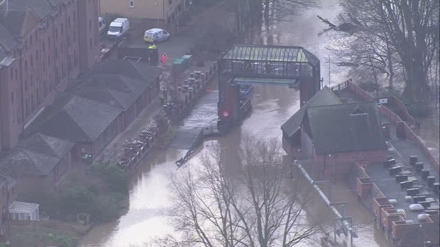 Exterior aerial shots of the Foss River and Foss Barrier open letting swollen river flow through on December 28 2015 in York United Kingdom