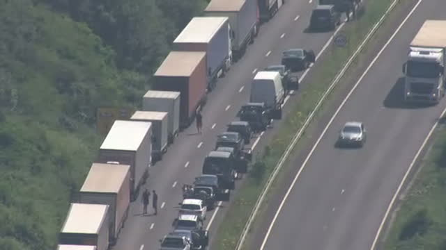 exterior aerial shots of the m20 motorway outside dover with queues of stationary lorries and cars due to extra french border checks on july 23 2016... - stationary stock videos & royalty-free footage