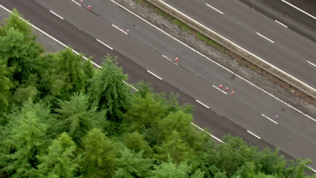 exterior aerial shots of the m25 motorway with a closed lane and recent repair work after sink holes appeared overnight after heavy rainfall on 11... - motorway stock videos & royalty-free footage