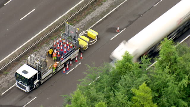 exterior aerial shots of the m25 motorway with a closed lane and recent repair work after sink holes appeared overnight after heavy rainfall on 11... - m25 video stock e b–roll