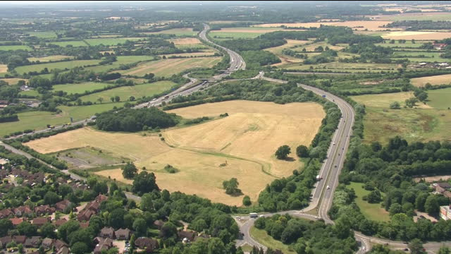 stockvideo's en b-roll-footage met exterior aerial shots of the m4 motorway as it snakes through farmland and countryside towards reading on 18 july 2017 in reading, united kingdom - berkshire engeland