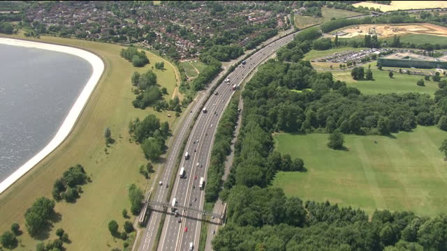 exterior aerial shots of the m4 motorway from langley, passing the queen mother reservoir and along tghe jubilee river on 18 july 2017 in slough,... - berkshire england stock videos & royalty-free footage