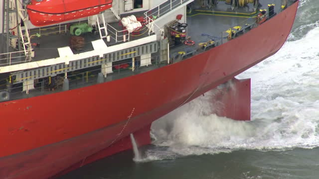 exterior aerial shots of the sega sky cargo ship at sea in choppy waters surrounded by a tug boat and an rnli rescue vessel after it began taking on... - ärmelkanal stock-videos und b-roll-filmmaterial