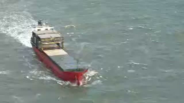 exterior aerial shots of the sega sky cargo ship at sea in choppy waters surrounded by a tug boat and an rnli rescue vessel after it began taking on... - sea channel stock videos and b-roll footage