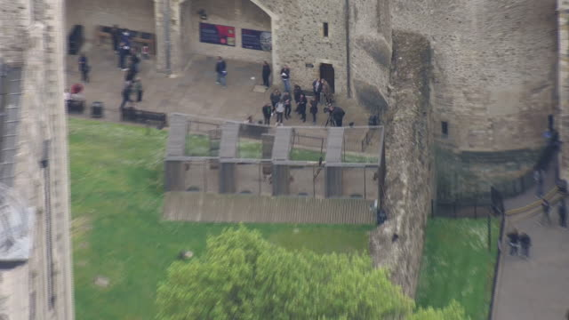 exterior aerial shots of the tower of london and tourists looking around it on 16 may 2019 in london, united kingdom - tower of london stock videos & royalty-free footage