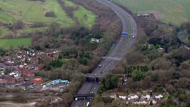 stockvideo's en b-roll-footage met exterior aerial shots of traffic on the m25 motorway the day before christmas eve on december 23 2016 in london england - meerdere baans snelweg