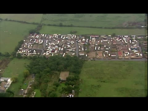 exterior aerial shots of travellers site including caravans portable homes on dale farm in crays hill billericay - デールファーム点の映像素材/bロール