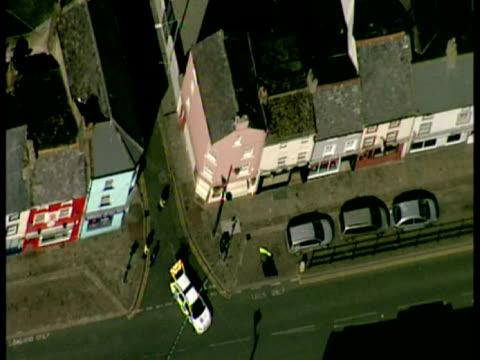 exterior aerial shots of various crime scenes in residential areas of rowrah frizington showing police cars and police cordons after derrick bird... - derrick bird cumbria stock-videos und b-roll-filmmaterial
