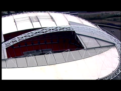 exterior aerial shots of wembley stadium with racing track being laid down over the pitch for the race of champions event - stabilimento sportivo video stock e b–roll