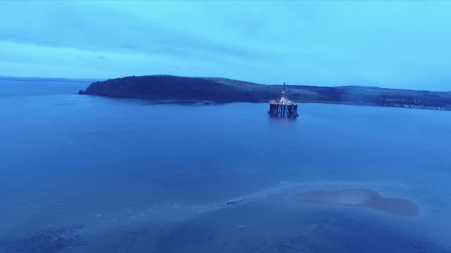 exterior aerial shots oil drilling rig anchored in the cromarty firth at dawn on january 28 2016 in cromarty scotland - oil exploration platform stock videos & royalty-free footage