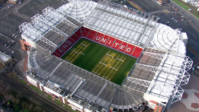 exterior aerial shots old trafford stadium home of manchester united football club who play in the english premier league. on february 10, 2016 in... - hitting stock videos & royalty-free footage