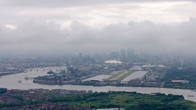 Exterior aerial shots over a rainy London showing the swollen river Thames and grey rain clouds as severe rainfall hits the UK on June 23 2016 in...