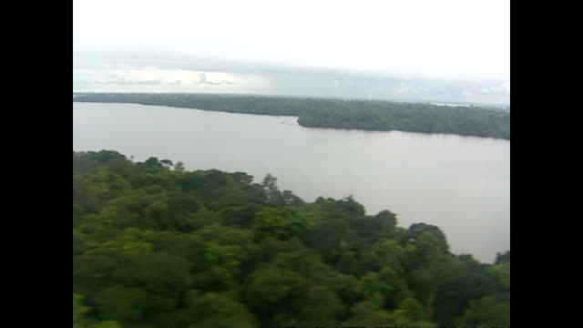 Exterior aerial shots over a river delta and forested area on December 16 2003 in Libreville Gabon
