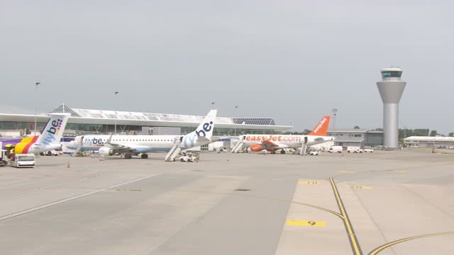 exterior aerial shots over jersey airport including the new control tower runway and easyjet and flybe planes at the terminal on july 04 2015 in... - 英国海峡 チャンネル諸島点の映像素材/bロール