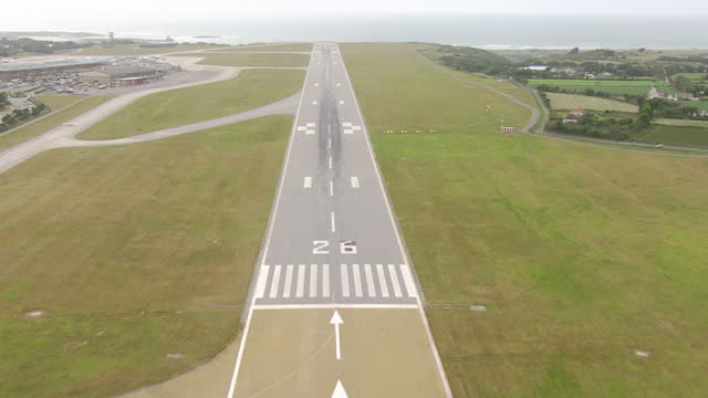 Exterior aerial shots over Jersey airport including the new control tower runway and Easyjet and Flybe planes at the terminal on July 04 2015 in...