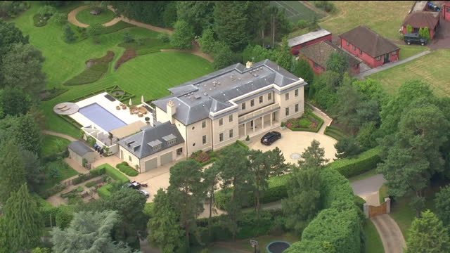 exterior aerial shots over large virginia water mansions and the wentworth golf course on 20 july 2017 in virginia water united kingdom - herrenhaus stock-videos und b-roll-filmmaterial