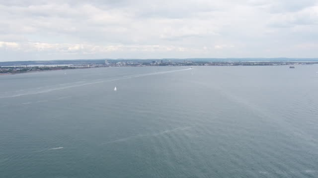 exterior aerial shots over portsmouth harbour and the solent with a hovercraft and a wight link hybrid ferry making the crossing between the mainland... - hovercraft stock videos & royalty-free footage