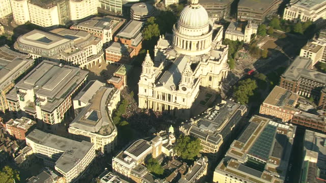 exterior aerial shots over st paul's cathedral with hundreds of protesters congregated near the steps occupy london protest aerials on october 15... - cathedral stock videos & royalty-free footage