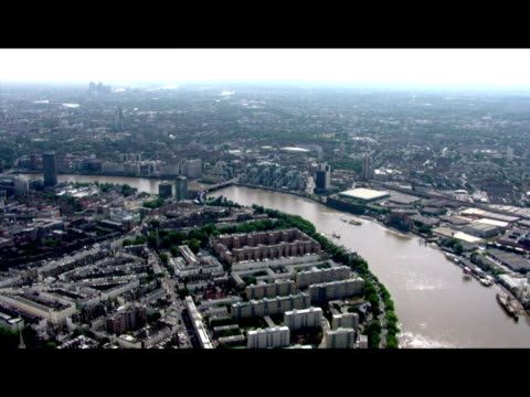 Exterior aerial shots passing along the River Thames from Battersea towards the City on a clear sunny day Exterior aerials shots of the Gherkin and...