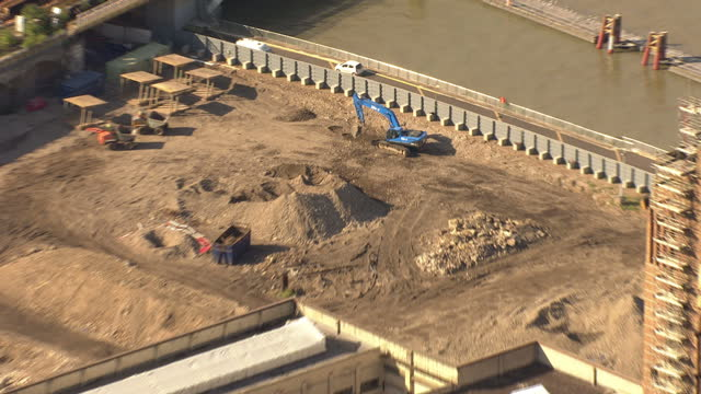 exterior aerial shots showing battersea power station next to the river thames with construction work going on around the building on september 20... - バタシー発電所点の映像素材/bロール