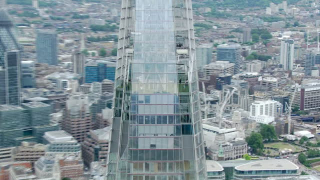 exterior aerial shots showing the shard skyscraper at london bridge with people seen on the viewing level and the city of london financial district... - shard london bridge stock videos & royalty-free footage
