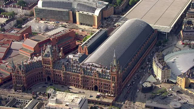 Exterior aerial shots St Pancras International Station with Eurostar trains at platforms and Southeastern train leaving station on September 20 2015...