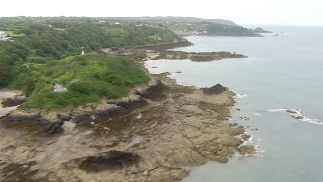 exterior aerial shots sweeping across jersey's rocky granite coastline on july 04, 2015 in saint helier, england. - channel islands england stock videos & royalty-free footage