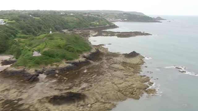 stockvideo's en b-roll-footage met exterior aerial shots sweeping across jersey's rocky granite coastline on july 04 2015 in saint helier england - kanaaleilanden engeland