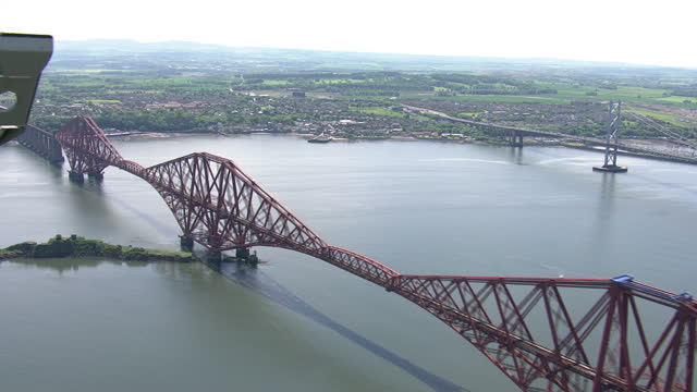 exterior aerial shots the forth railway bridge over the firth of forth on june 11th 2014 in edinburgh scotland - firth of forth stock videos & royalty-free footage