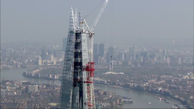 exterior aerial shots the shard london bridge tower in the final stages of its construction at the peak exterior aerial shots construction workers... - peak tower stock videos and b-roll footage