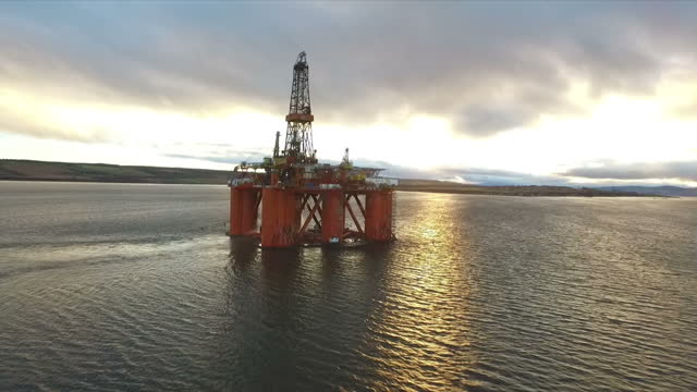 exterior aerial shots the west phoenix oil drilling rig anchored in the cromarty firth, at dawn. on january 28, 2016 in cromarty, scotland. - anchored stock videos & royalty-free footage