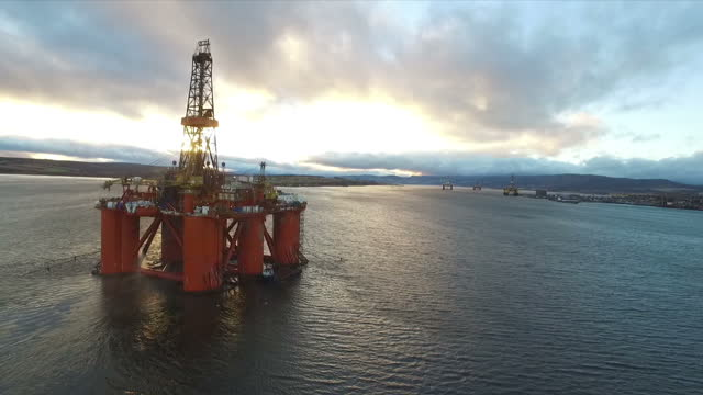 exterior aerial shots the west phoenix oil drilling rig anchored in the cromarty firth at dawn on january 28 2016 in cromarty scotland - drill stock videos & royalty-free footage