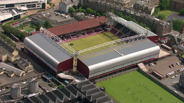 exterior aerial shots tynecastle stadium home to hearts football club with tractor preparing pitch for new football season. on february 23, 2014 in... - 2014 stock-videos und b-roll-filmmaterial