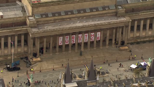 exterior aerial shots words 'truth and justice' spelt out in large letters on the front of st george's hall in liverpool city centre on day the... - シェフィールド点の映像素材/bロール