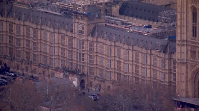 exterior aerial views at dusk of the palace of westminster westminster abbey as indicative votes take place in the house of commons on 27 march 2019... - house of commons stock videos & royalty-free footage