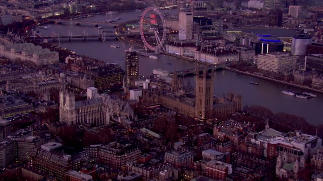 exterior aerial views at dusk of the palace of westminster westminster abbey whitehall and the treasury other government buildings including the... - house of commons stock videos & royalty-free footage