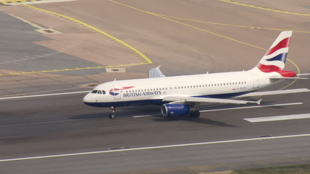 exterior aerial views of a british airways plane taking off as other planes are parked at heathrow airport due to an it system failure on 7 august... - off stock videos & royalty-free footage