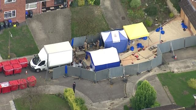 exterior aerial views of army forensic activity outside charlie rowley's house in amesbury, including forensic tents, boarded up windows and doors... - toxic substance stock videos & royalty-free footage