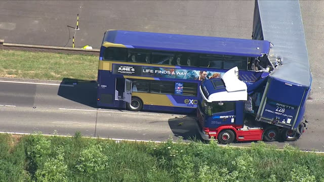 Exterior aerial views of Bus and Lorry crash in Cambridgeshire near Wisbech including pan in to close up showing damage to both vehicles and cordoned...