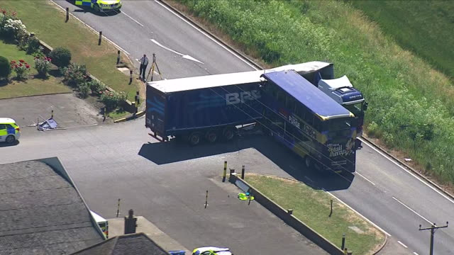 Exterior aerial views of Bus and Lorry crash in Cambridgeshire near Wisbech showing damage to both vehicles and cordoned off road by emergency...