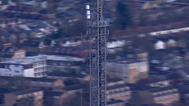 exterior aerial views of crystal palace transmitting station, showing the mast with city of london in the background, also includes croydon... - communications tower stock videos & royalty-free footage